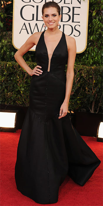 011313-allison-williams-black J Mendel sequin seamed halter gown with a deep V neckline